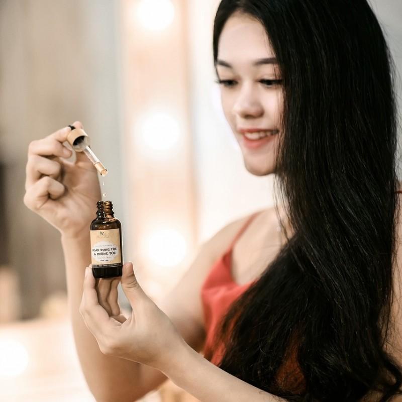 huile et femme au cheveux longs